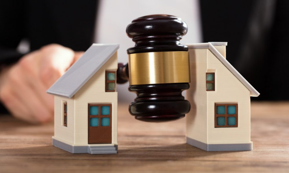 Gavel separating a toy house